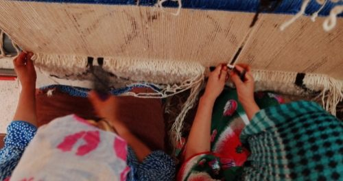 Women making artisan rugs